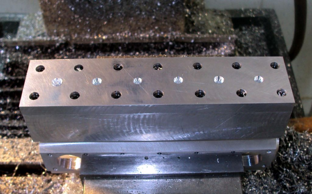 center drilling cylinder holes.jpg