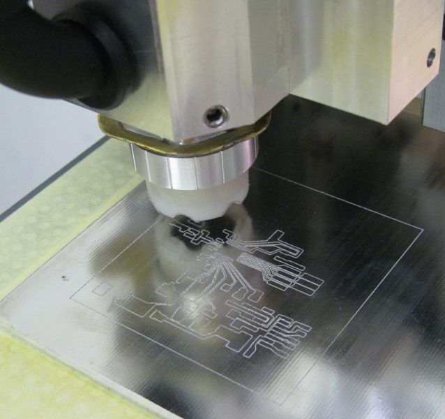 PCB Being Engraved