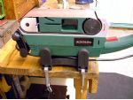 The belt sander as supplied, mounted on the bench